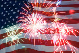 fiireworks bursts with American Flag behind it
